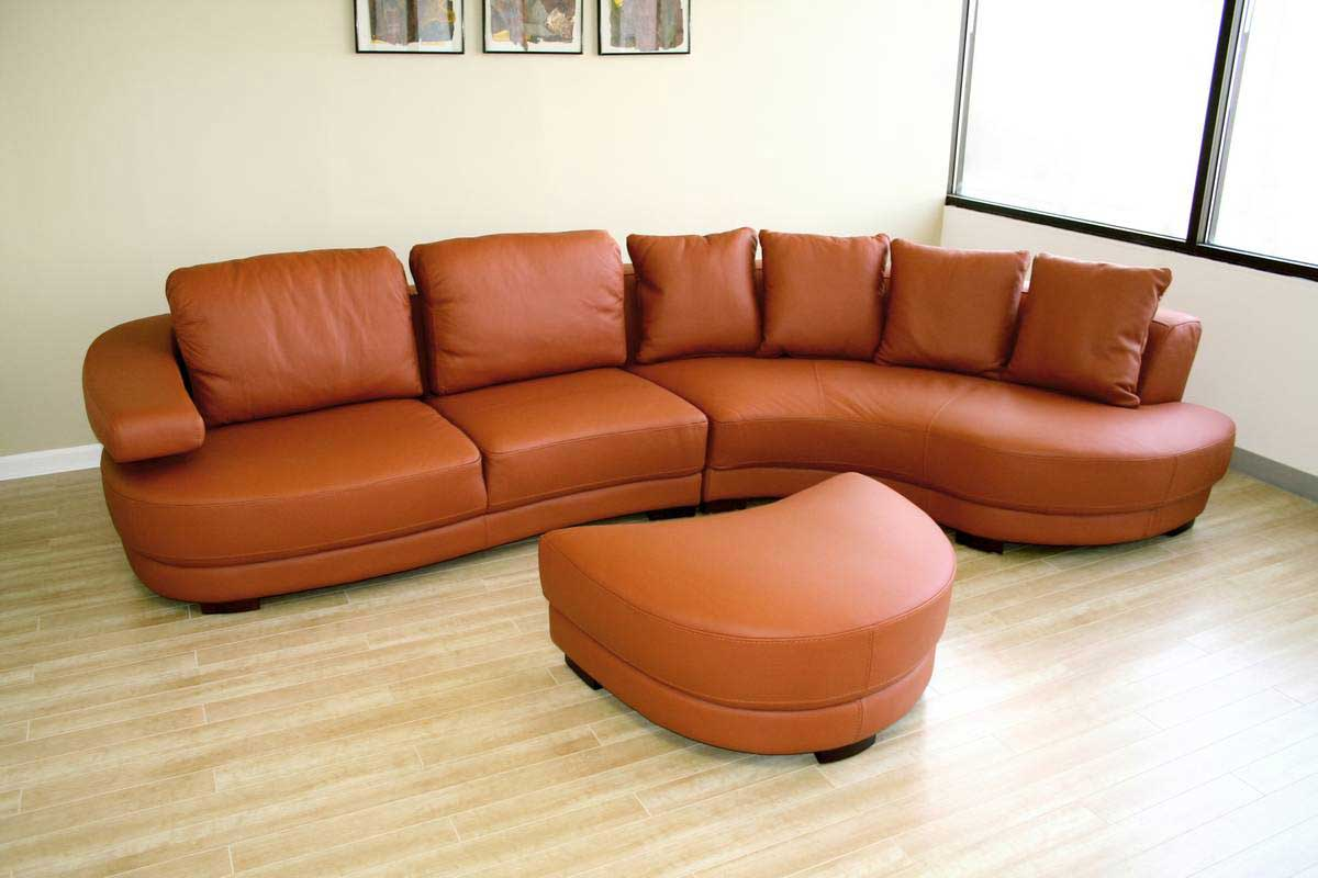 Upholstered orange leather office sofa with ottoman